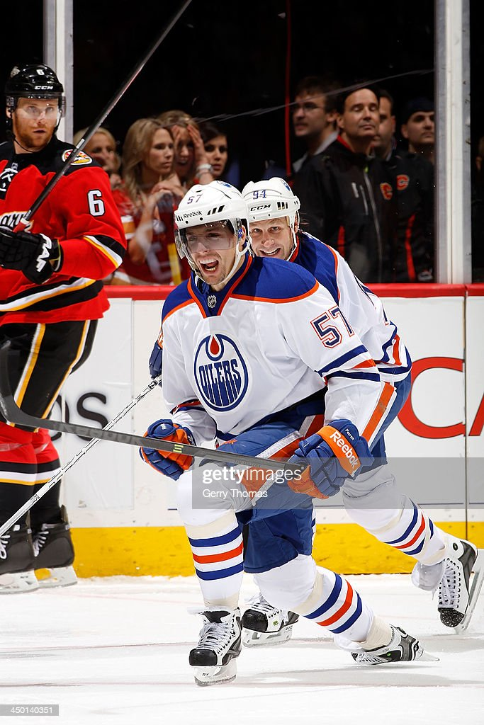 <a gi-track='captionPersonalityLinkClicked' href=/galleries/search?phrase=David+Perron&family=editorial&specificpeople=4282591 ng-click='$event.stopPropagation()'>David Perron</a> #57 of the Edmonton Oilers celebrates a goal against the Calgary Flames at Scotiabank Saddledome on November 16, 2013 in Calgary, Alberta, Canada.