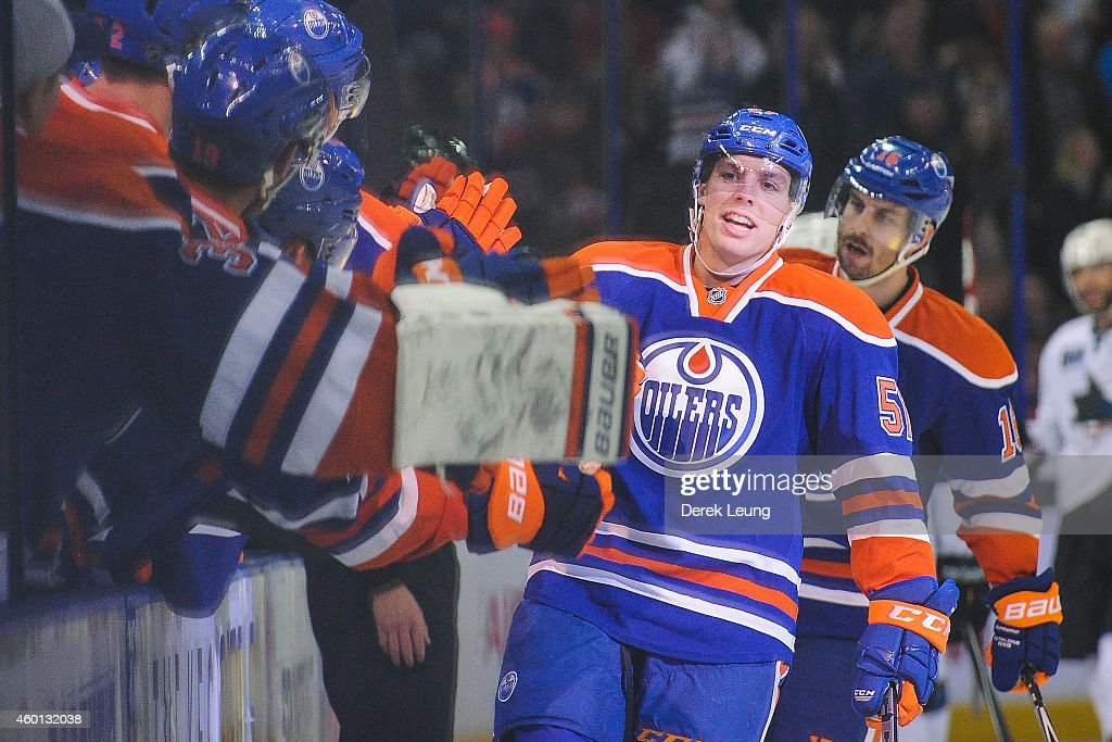 David Perron of the Edmonton Oilers celebrates after scoring the gamewinning goal against the San Jose Sharks during an NHL game at Rexall Place on...
