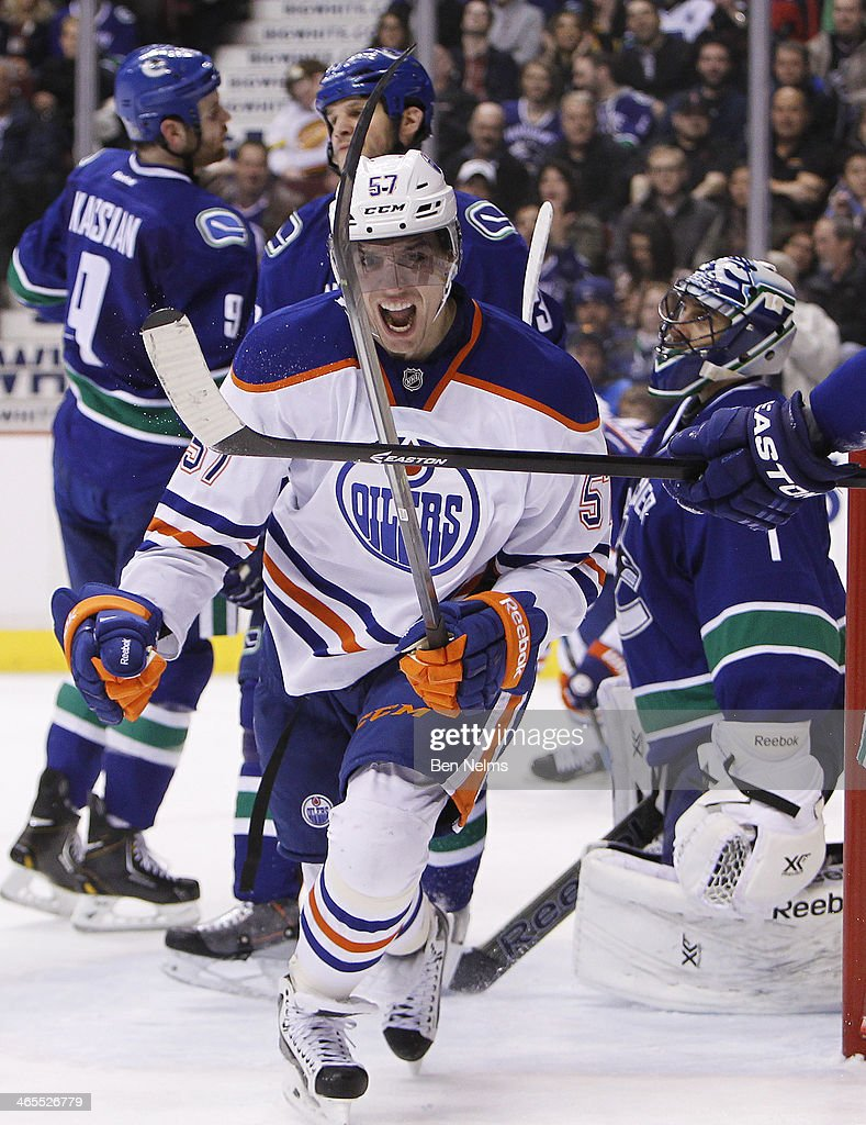 David Perron of the Edmonton Oilers celebrates his goal against goaltender Roberto Luongo of the Vancouver Canucks during the first period of their...