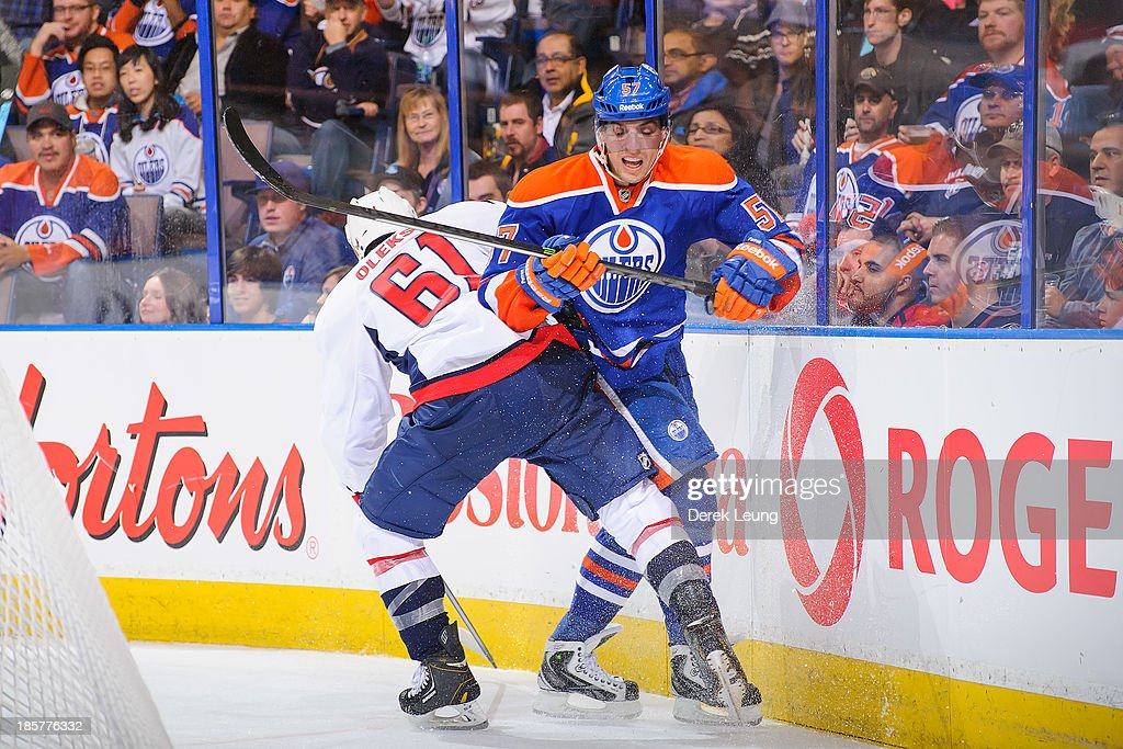 <a gi-track='captionPersonalityLinkClicked' href=/galleries/search?phrase=David+Perron&family=editorial&specificpeople=4282591 ng-click='$event.stopPropagation()'>David Perron</a> #57 of the Edmonton Oilers collides with Steve Oleksy #61 of the Washington Capitals during an NHL game at Rexall Place on October 24, 2013 in Edmonton, Alberta, Canada.