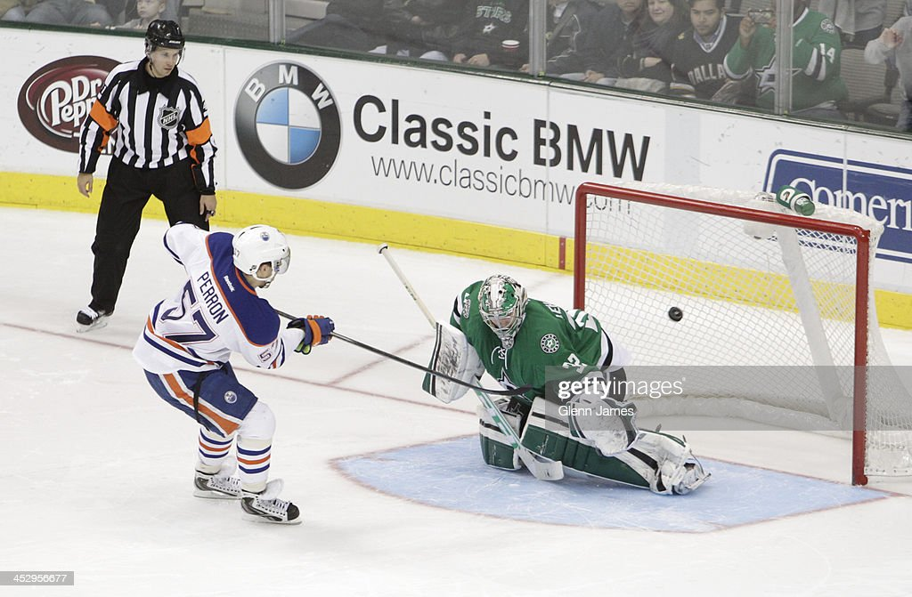 David Perron of the Edmonton Oilers nets a shootout goal against Kari Lehtonen of the Dallas Stars at the American Airlines Center on December 1 2013...
