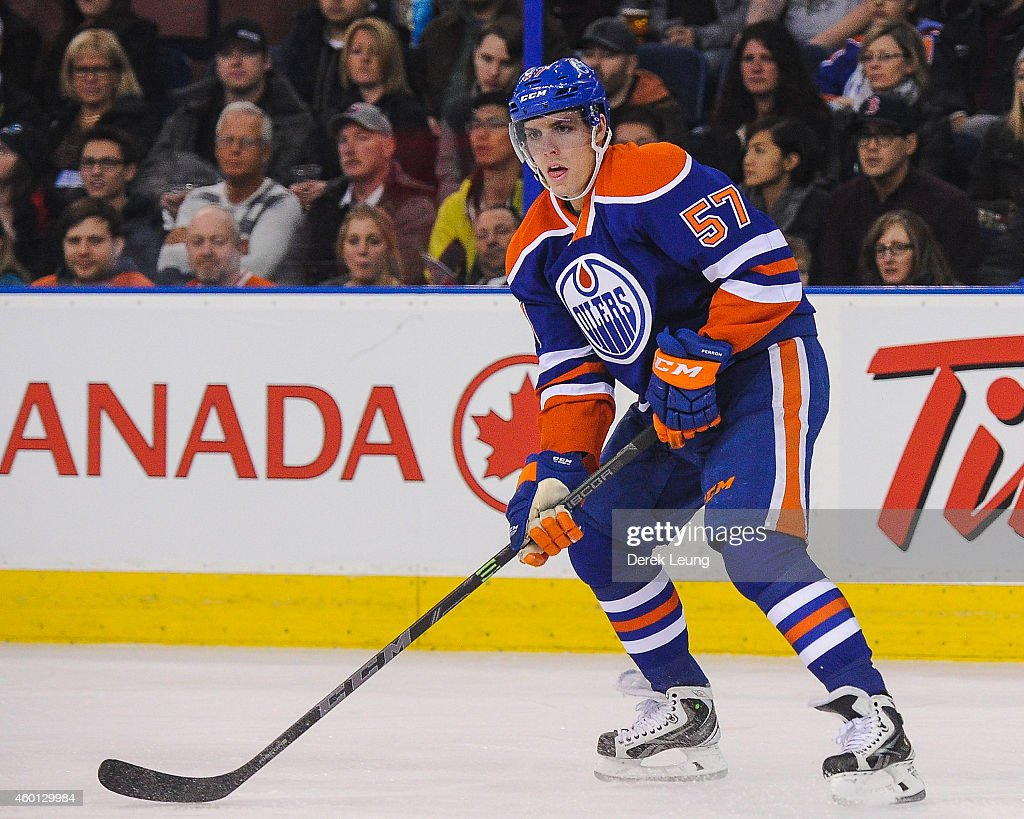 David Perron of the Edmonton Oilers skates against the San Jose Sharks during an NHL game at Rexall Place on December 7 2014 in Edmonton Alberta...