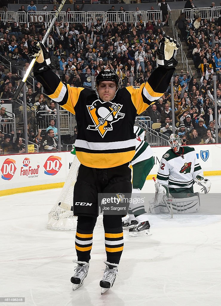 David Perron of the Pittsburgh Penguins celebrates his goal in front of Niklas Backstrom of the Minnesota Wild during the first period at Consol...