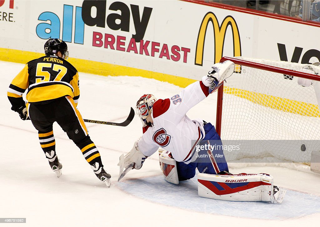 David Perron of the Pittsburgh Penguins scores the gam winning shootout goal against Mike Condon of the Montreal Canadiens during the game at Consol...