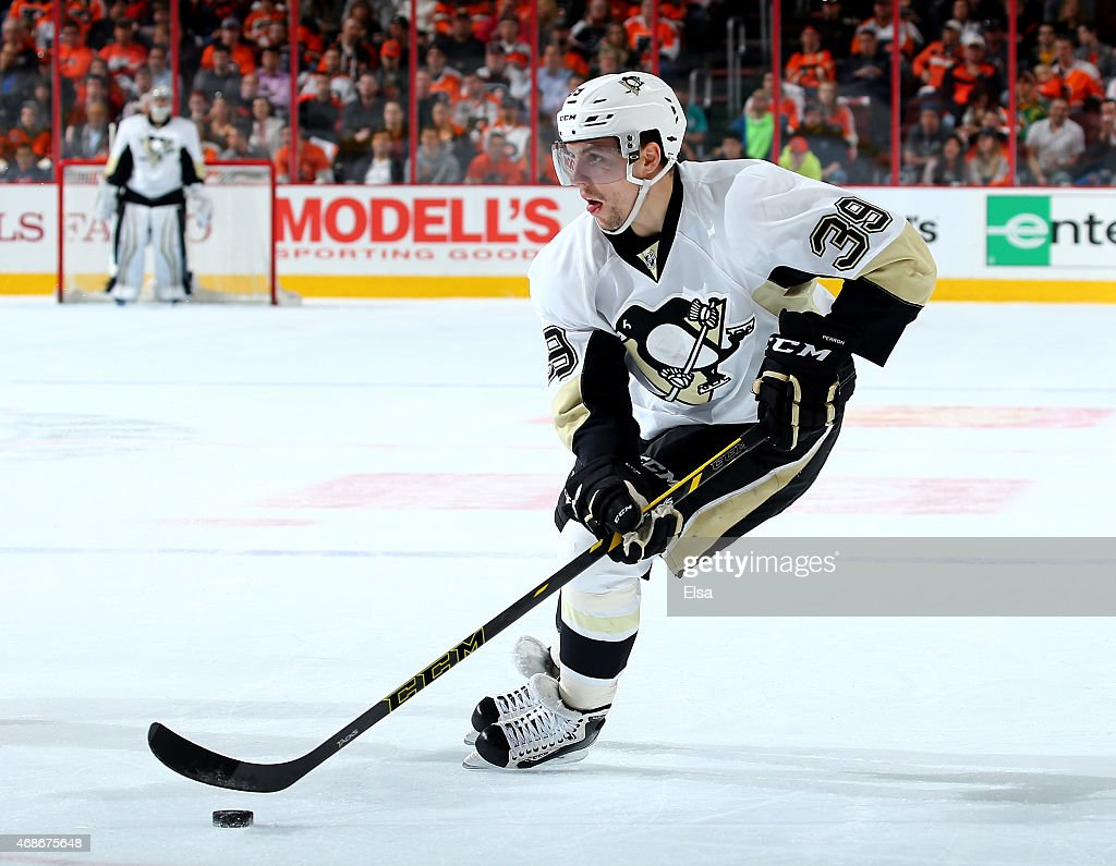 David Perron of the Pittsburgh Penguins takes the puck in the first period against the Philadelphia Flyers on April 5 2015 at the Wells Fargo Center...