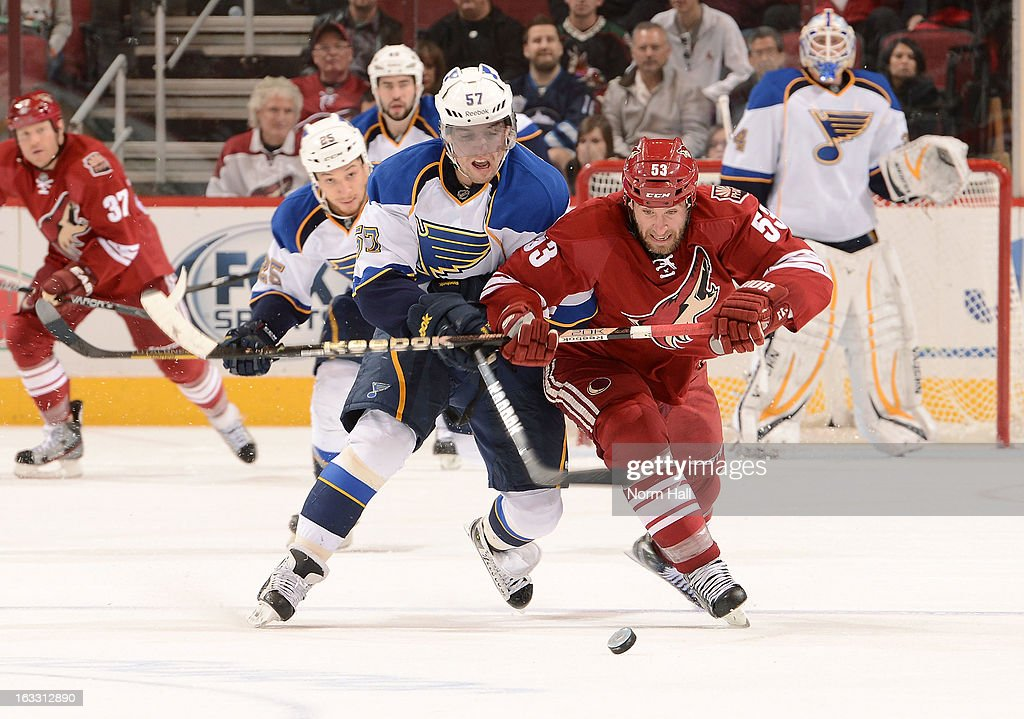 <a gi-track='captionPersonalityLinkClicked' href=/galleries/search?phrase=David+Perron&family=editorial&specificpeople=4282591 ng-click='$event.stopPropagation()'>David Perron</a> #57 of the St Louis Blues battles with <a gi-track='captionPersonalityLinkClicked' href=/galleries/search?phrase=Derek+Morris&family=editorial&specificpeople=204188 ng-click='$event.stopPropagation()'>Derek Morris</a> #53 of the Phoenix Coyotes for control of the puck during the third period at Jobing.com Arena on March 7, 2013 in Glendale, Arizona.