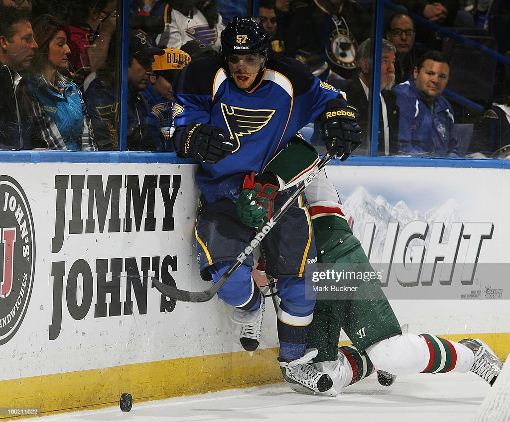 David Perron #57 of the St. Louis Blues chases a loose puck in an NHL game against the Minnesota Wild on January 27, 2013 at Scottrade Center in St. Louis, Missouri.