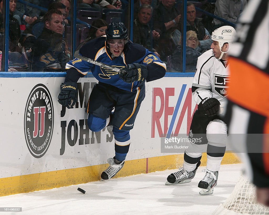 <a gi-track='captionPersonalityLinkClicked' href=/galleries/search?phrase=David+Perron&family=editorial&specificpeople=4282591 ng-click='$event.stopPropagation()'>David Perron</a> #57 of the St. Louis Blues chases a loose puck in an NHL game against the Los Angeles Kings on February 11, 2013 at Scottrade Center in St. Louis, Missouri.