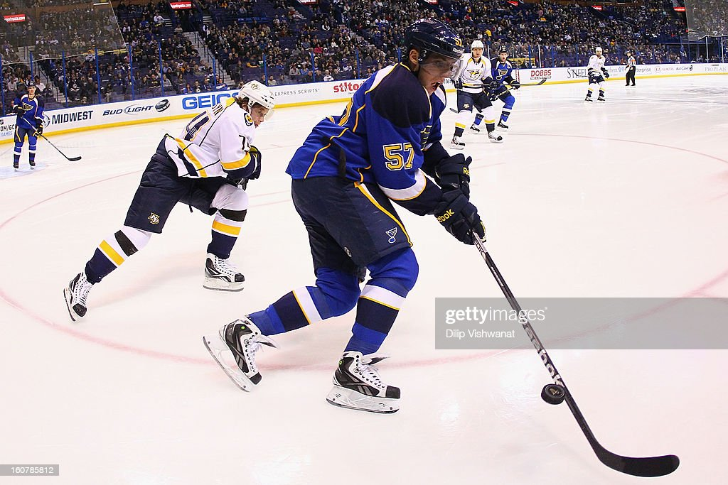 <a gi-track='captionPersonalityLinkClicked' href=/galleries/search?phrase=David+Perron&family=editorial&specificpeople=4282591 ng-click='$event.stopPropagation()'>David Perron</a> #57 of the St. Louis Blues clears the puck against <a gi-track='captionPersonalityLinkClicked' href=/galleries/search?phrase=Sergei+Kostitsyn&family=editorial&specificpeople=599906 ng-click='$event.stopPropagation()'>Sergei Kostitsyn</a> #74 of the Nashville Predators at the Scottrade Center on February 5, 2013 in St. Louis, Missouri.