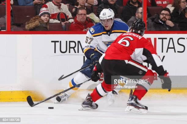 David Perron of the St Louis Blues controls the puck against Chris Wideman of the Ottawa Senators at Canadian Tire Centre on February 7 2017 in...