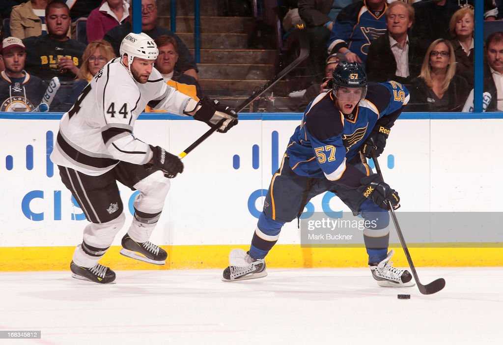 <a gi-track='captionPersonalityLinkClicked' href=/galleries/search?phrase=David+Perron&family=editorial&specificpeople=4282591 ng-click='$event.stopPropagation()'>David Perron</a> #57 of the St. Louis Blues handles the puck as <a gi-track='captionPersonalityLinkClicked' href=/galleries/search?phrase=Robyn+Regehr&family=editorial&specificpeople=171828 ng-click='$event.stopPropagation()'>Robyn Regehr</a> #44 of the Los Angeles Kings defends in Game Five of the Western Conference Quarterfinals during the 2013 NHL Stanley Cup Playoffs on May 8, 2013 at Scottrade Center in St. Louis, Missouri.