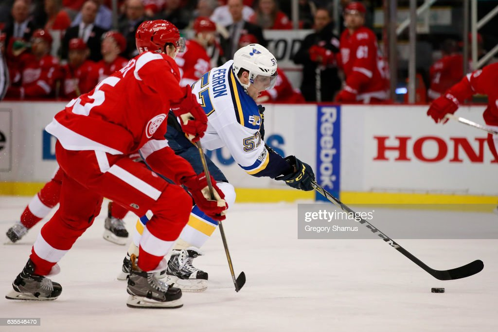 David Perron #57 of the St. Louis Blues heads up ice against Danny DeKeyser #65 of the Detroit Red Wings during the third period at Joe Louis Arena on February 15, 2017 in Detroit, Michigan. St. Louis won the game 2-0.