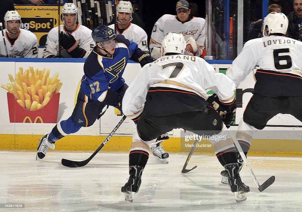 <a gi-track='captionPersonalityLinkClicked' href=/galleries/search?phrase=David+Perron&family=editorial&specificpeople=4282591 ng-click='$event.stopPropagation()'>David Perron</a> #57 of the St. Louis Blues shoots as <a gi-track='captionPersonalityLinkClicked' href=/galleries/search?phrase=Andrew+Cogliano&family=editorial&specificpeople=869296 ng-click='$event.stopPropagation()'>Andrew Cogliano</a> #7 and <a gi-track='captionPersonalityLinkClicked' href=/galleries/search?phrase=Ben+Lovejoy&family=editorial&specificpeople=4509565 ng-click='$event.stopPropagation()'>Ben Lovejoy</a> #6 of the Anaheim Ducks defend in an NHL game on March 16, 2013 at Scottrade Center in St. Louis, Missouri.
