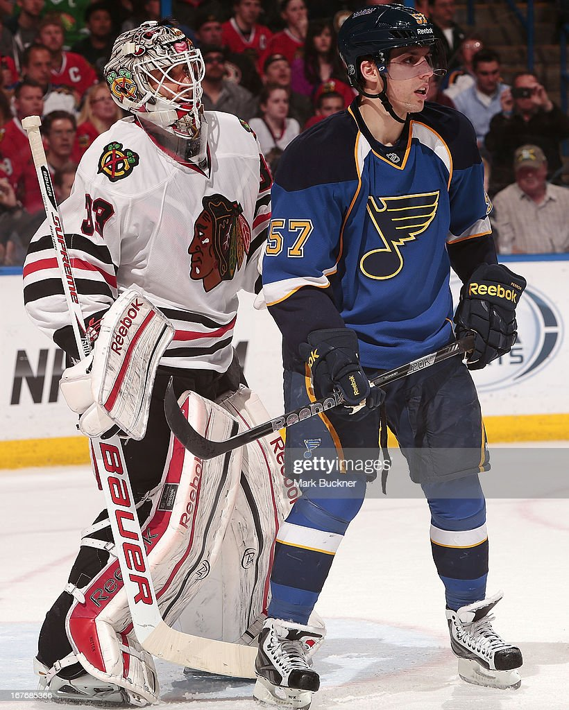 David Perron #57 of the St. Louis Blues skates in front of Carter Hutton #33 of the Chicago Blackhawks in an NHL game on April 27, 2013 at Scottrade Center in St. Louis, Missouri.