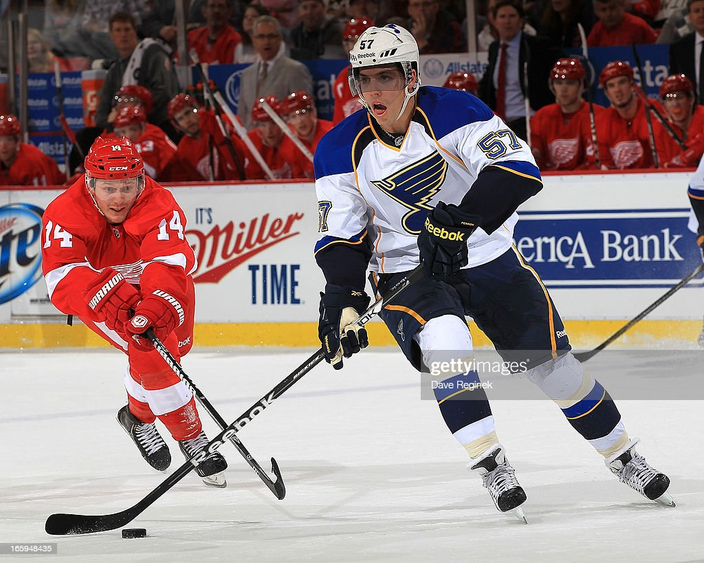<a gi-track='captionPersonalityLinkClicked' href=/galleries/search?phrase=David+Perron&family=editorial&specificpeople=4282591 ng-click='$event.stopPropagation()'>David Perron</a> #57 of the St. Louis Blues skates with the puck as Gustav Nyquist #14 of the Detroit Red Wings reaches to lift his stick during a NHL game at Joe Louis Arena on April 7, 2013 in Detroit, Michigan.