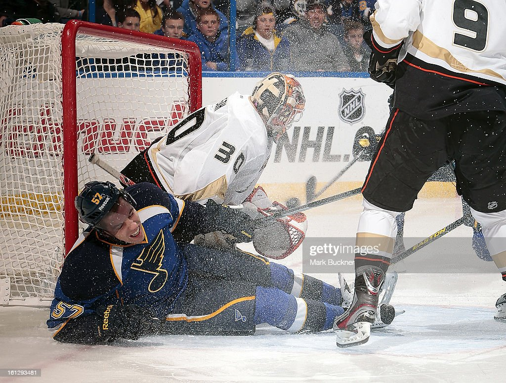 <a gi-track='captionPersonalityLinkClicked' href=/galleries/search?phrase=David+Perron&family=editorial&specificpeople=4282591 ng-click='$event.stopPropagation()'>David Perron</a> #57 of the St. Louis Blues slides into goalie Viktor Fasth #30 of the Anaheim Ducks in an NHL game on February 9, 2013 at Scottrade Center in St. Louis, Missouri.