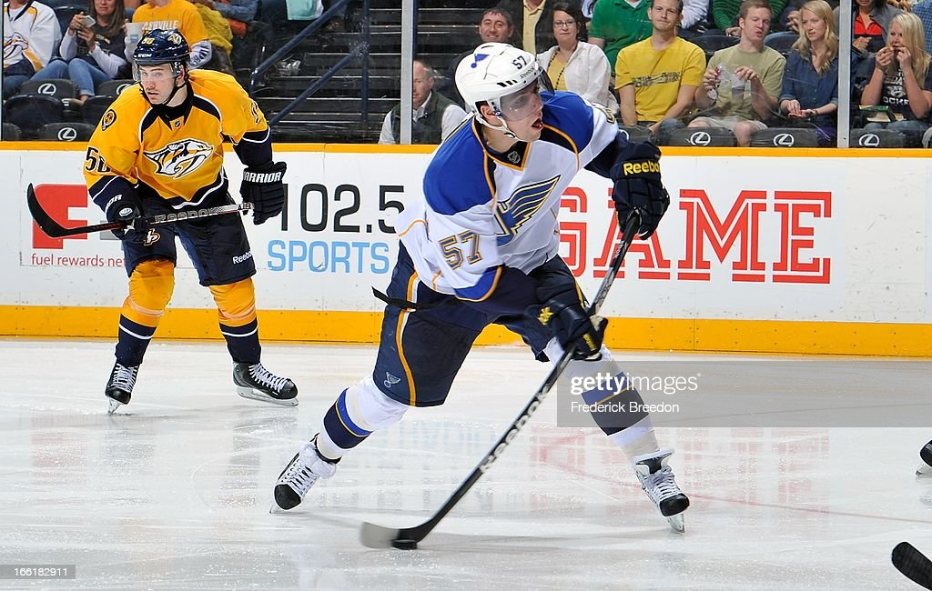 <a gi-track='captionPersonalityLinkClicked' href=/galleries/search?phrase=David+Perron&family=editorial&specificpeople=4282591 ng-click='$event.stopPropagation()'>David Perron</a> #57 of the St Louis Blues takes a shot against the Nashville Predators at the Bridgestone Arena on April 9, 2013 in Nashville, Tennessee.