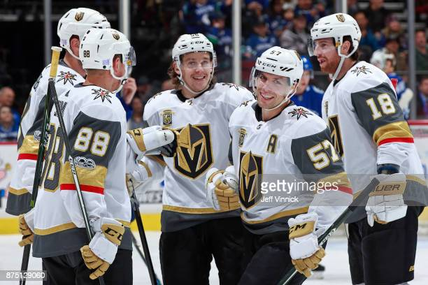 David Perron of the Vegas Golden Knights is congratulated by teammates after scoring during their NHL game against the Vancouver Canucks at Rogers...