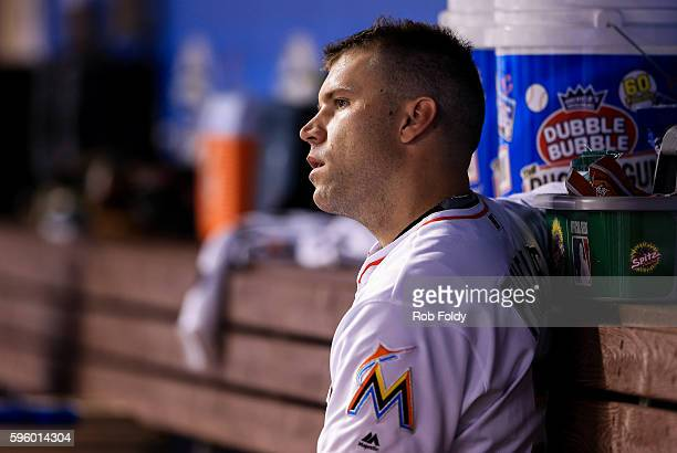 David Phelps of the Miami Marlins looks on from the dugout during the game against the San Diego Padres at Marlins Park on August 26 2016 in Miami...