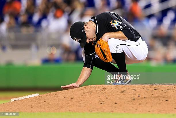 David Phelps of the Miami Marlins pauses on the mound to honor the late Jose Fernandez during the game against the New York Mets at Marlins Park on...