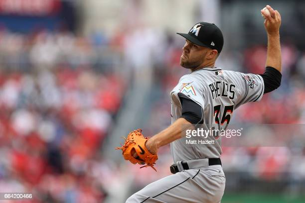 David Phelps of the Miami Marlins pitches against the Washington Nationals in the seventh inning of the opening day game at Nationals Park on April 3...