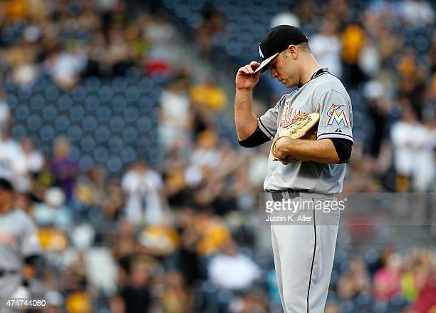 David Phelps of the Miami Marlins reacts after giving up a three run home run in the second inning during the game against the Pittsburgh Pirates at...
