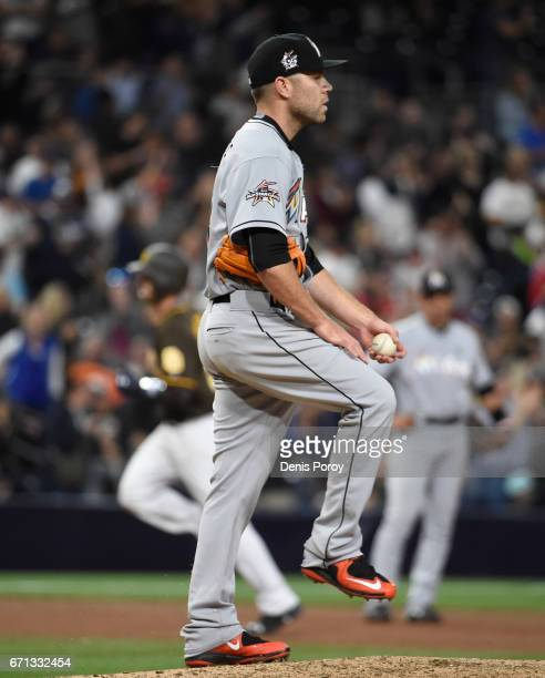 David Phelps of the Miami Marlins stands on the mound after giving up a threerun home run to Austin Hedges of the San Diego Padres during the seventh...
