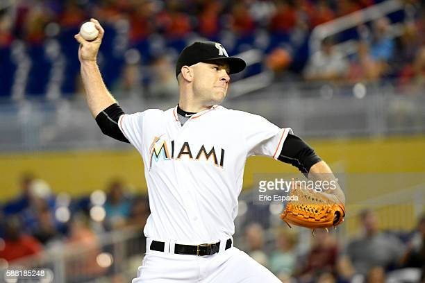 David Phelps of the Miami Marlins throws a pitch during the first inning against the San Francisco Giants at Marlins Park on August 10 2016 in Miami...