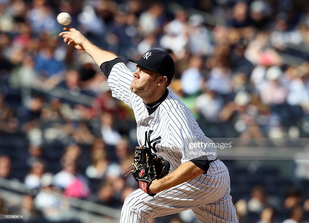 David Phelps #41 of the New York Yankees pitches against the Tampa Bay Rays at Yankee Stadium on September 16, 2012 in the Bronx borough of New York City.