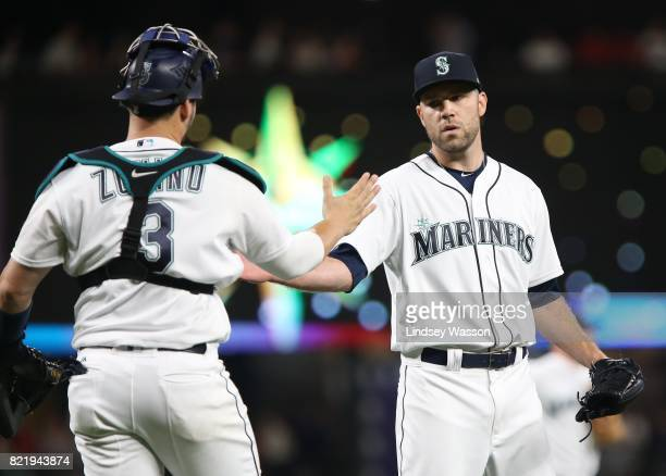 David Phelps of the Seattle Mariners is greeted by Mike Zunino after striking out Hanley Ramirez of the Boston Red Sox to win in the ninth inning at...