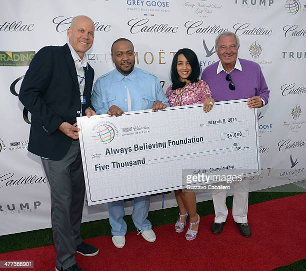 David PillsburyTimbaland Monique Mosley and Butch Buchholz attend GREY GOOSE Vodka and the Cadillac Championship Toast Travie McCoy at the Trump...