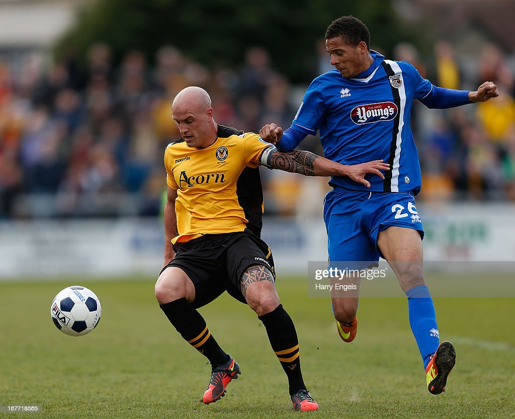 David Pipe of Newport County (L) beats Marcus Marshall of Grimsby Town to the ball during the Blue Square Bet Premier Conference Play-off second leg match between Newport County A.F.C. and Grimsby Town at Rodney Parade on April 28, 2013 in Newport, Wales.