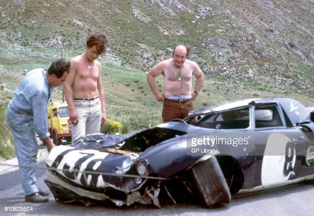 David Piper Franco Zucchi and Tony Lanfranchi survey wreckage of Ferrari 250LM at Targa Florio