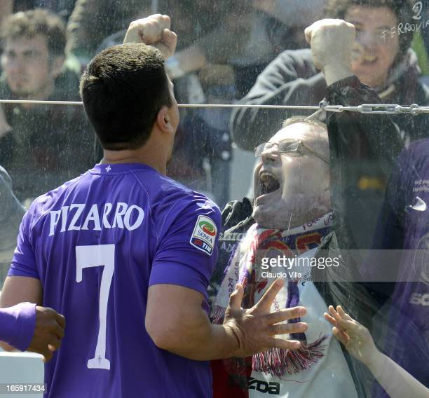 David Pizarro of ACF Fiorentina celebrates in front of fans after scoring his team's second goal from a penalty during the Serie A match between ACF...