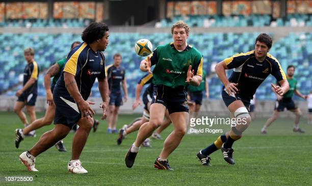 David Pocock catches the ball during an Australian Wallabies training session at the Moses Mahiba Stadium on August 30 2010 in Durban South Africa
