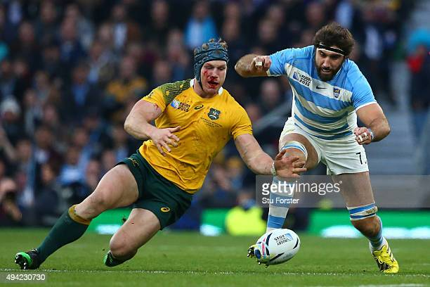 David Pocock of Australia and Juan Martin Fernandez Lobbe of Argentina compete for the loose ball during the 2015 Rugby World Cup Semi Final match...