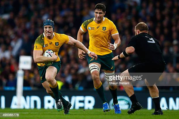 David Pocock of Australia goes past Owen Franks of New Zealand during the 2015 Rugby World Cup Final match between New Zealand and Australia at...