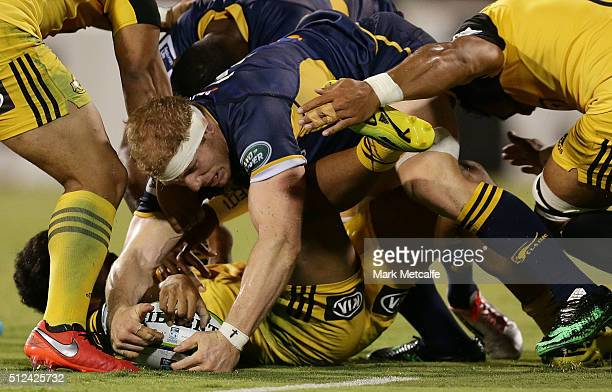 David Pocock of the Brumbies competes for the ball at a ruck during the round one Super Rugby match between the Brumbies and the Hurricanes at GIO...