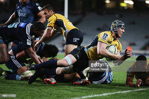 David Pocock of the Brumbies dives forward during the round nine Super Rugby match between the Blues and the Brumbies at Eden Park on April 10 2015...