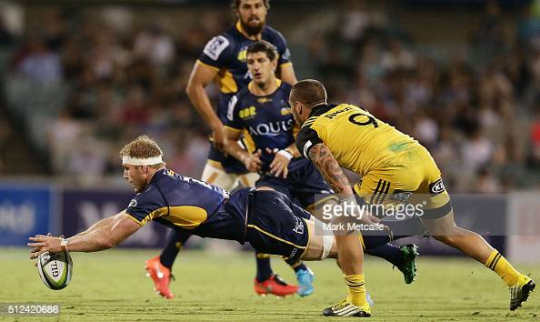 David Pocock of the Brumbies dives on a loose ball during the round one Super Rugby match between the Brumbies and the Hurricanes at GIO Stadium on...