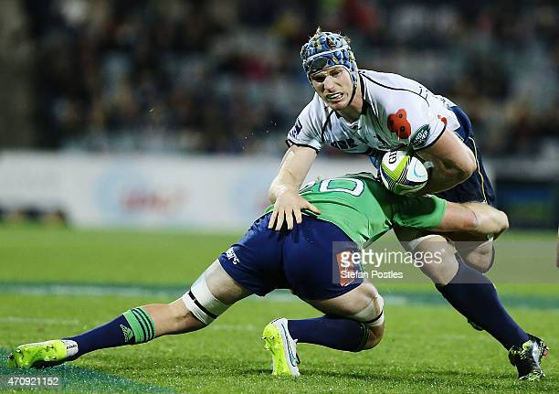 David Pocock of the Brumbies is tackled during the round 11 Super Rugby match between the Brumbies and the Highlanders at GIO Stadium on April 24...
