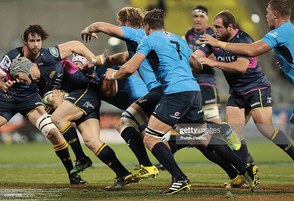 <a gi-track='captionPersonalityLinkClicked' href=/galleries/search?phrase=David+Pocock&family=editorial&specificpeople=636603 ng-click='$event.stopPropagation()'>David Pocock</a> of the Brumbies is tackled during the round 11 Super Rugby match between the Brumbies and the Bulls at GIO Stadium on May 6, 2016 in Canberra, Australia.