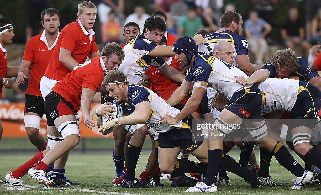 <a gi-track='captionPersonalityLinkClicked' href=/galleries/search?phrase=David+Pocock&family=editorial&specificpeople=636603 ng-click='$event.stopPropagation()'>David Pocock</a> of the Brumbies scores a try during the Super Rugby trial match between the Brumbies and the ACT XV at Viking Park on February 8, 2013 in Canberra, Australia.