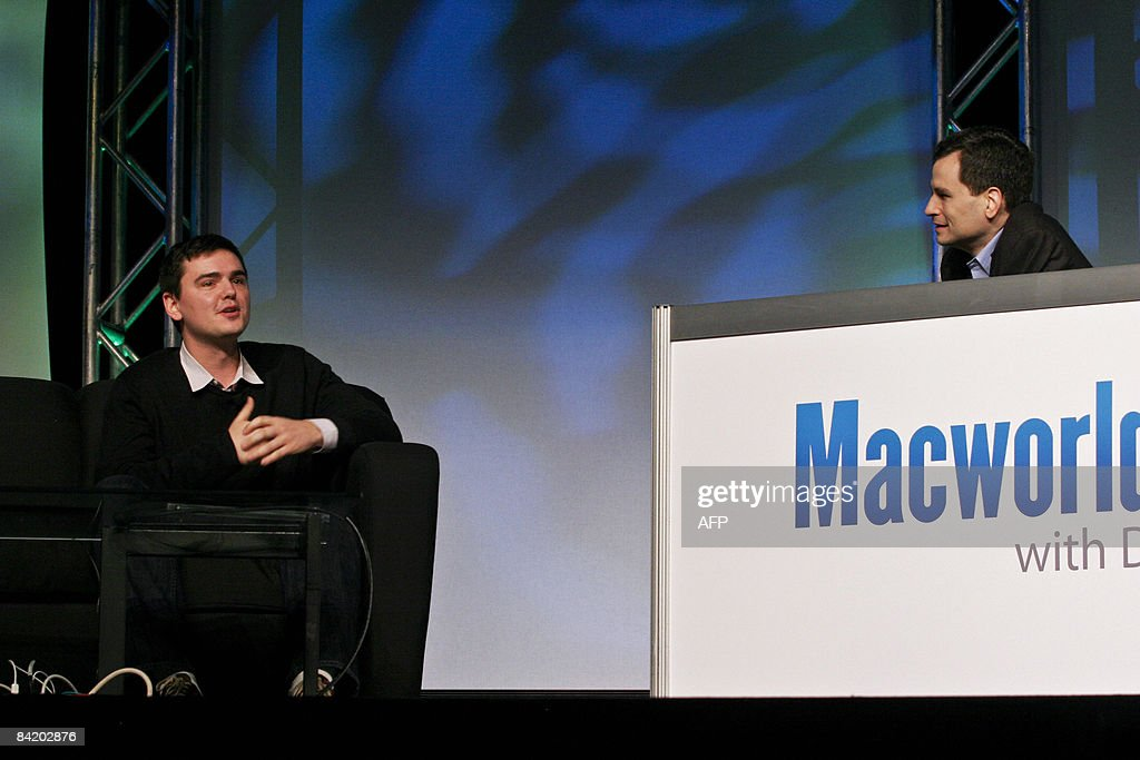 David Pogue (R), a technology columnist for the New York Times, speaks with video game designer and Internet celebrity Matt Harding about his international dancing videos during the Macworld Expo 2009 in San Francisco, CA, Wednesday, Jan. 7, 2009. Tens of thousands of Macintosh consumers as well as Apple engineers and developers attended the annual technology fair where new Mac-compatible products were showcased along with the release of Apple's latest computer gadgets and software updates. New versions of iWork and iLife were also announced. AFP PHOTO / Ryan Anson