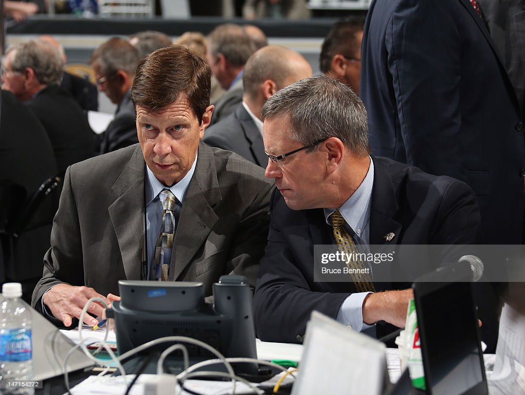 David Poile and Paul Fenton of the Nashville Predators attend day two of the 2012 NHL Entry Draft at Consol Energy Center on June 23, 2012 in Pittsburgh, Pennsylvania.