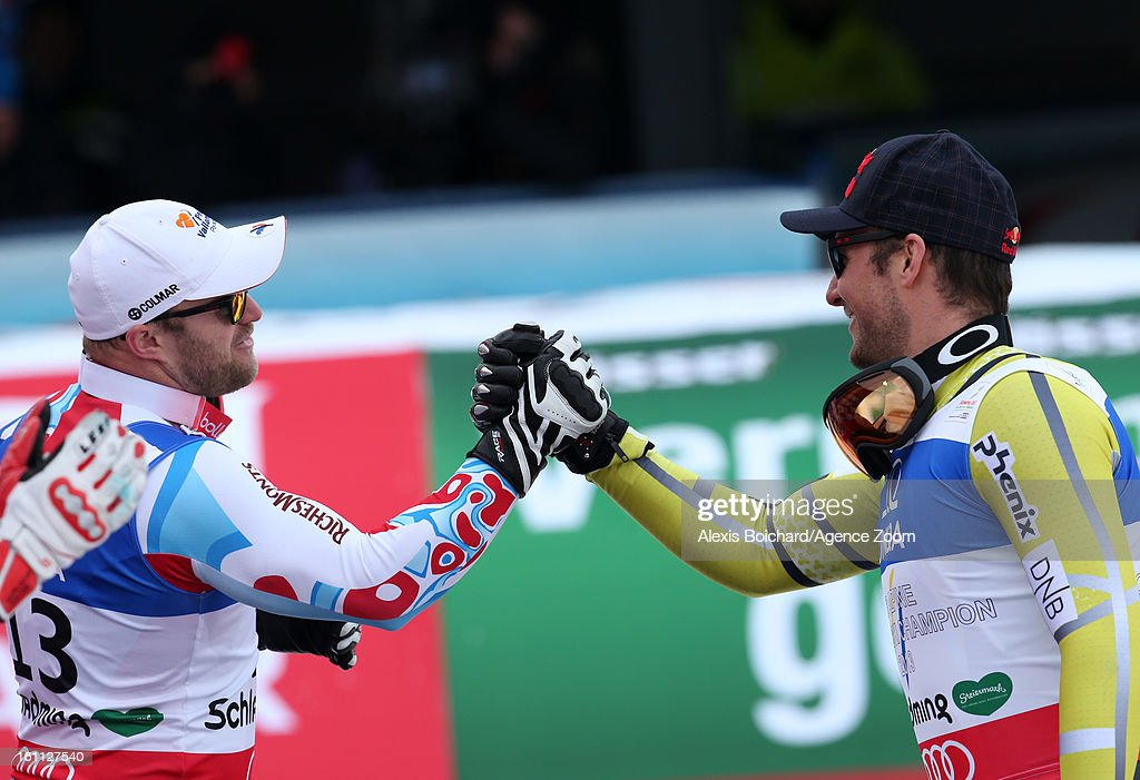 David Poisson of France wins the bronze medal and congratulates Aksel Lund Svindal of Norway who wins the gold medal during the Audi FIS Alpine Ski World Championships Men's Downhill on February 09, 2013 in Schladming, Austria.