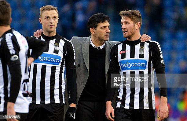 David Pollet of Charleroi celebrates with their head coach Felice Mazzu during the Jupiler League match between KRC Genk and RCSC Charleroi on...