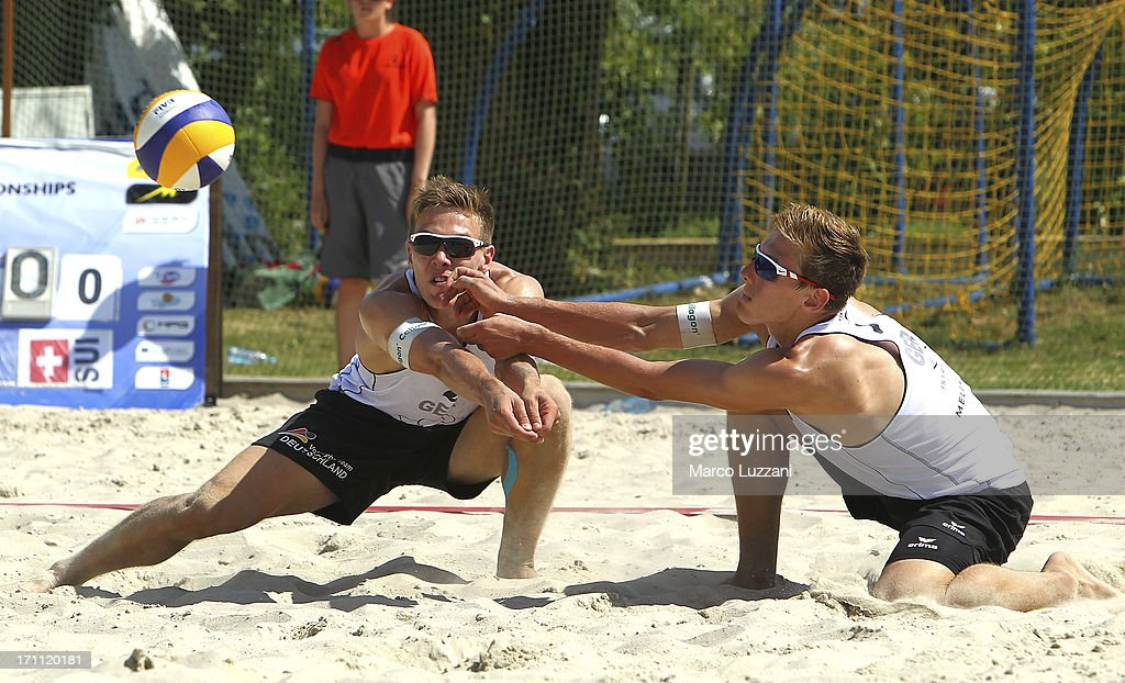 David Poniewaz and Bennet Poniewaz of Germany go to save the ball during FIVB Under 21 World Championships on June 22, 2013 in Umag, Croatia.