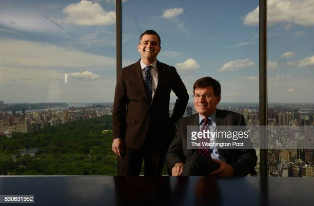 David Poppe right sitting CEO of Ruane Cunniff Goldfarb Inc and Jonathan Brandt analyst pose for portrait photographs at their office building on W...