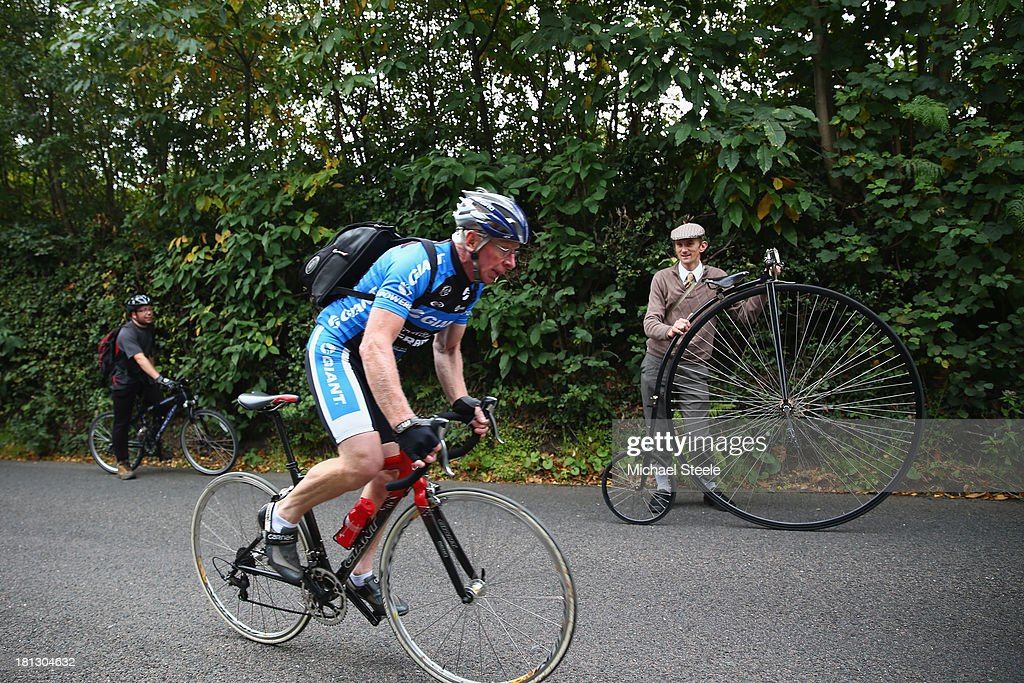 David Preece (R) takes a rest alongside his penny farthing bike as he makes his way towards the stage finish during stage six of the Tour of Britain from Sidmouth to Haytor on September 20, 2013 in Sidmouth, England.